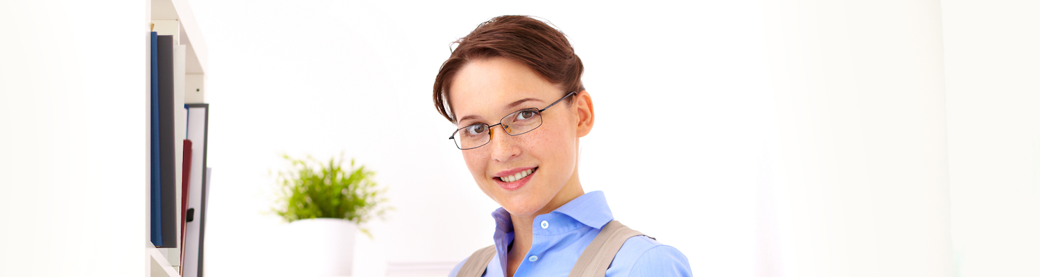 Young woman wearing glasses holding a file folder