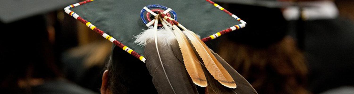 mortar board with native american feathers
